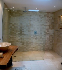 Mosaic tiling in wet room shower area