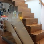 Oak staircase with glass flank wall
