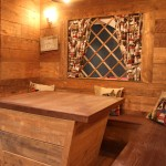 Banquette seating area with ski chalet faux window