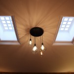 Luxcrete on either side of central caged chandelier pendant