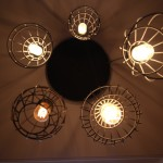Cage chandelier lighting over pool table